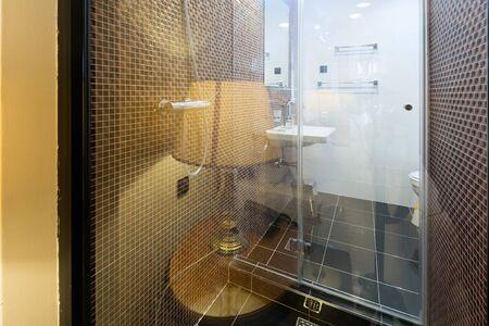 bathroom wall: View to a bathroom through glass wall Stock Photo