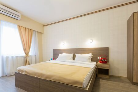 master bedroom: Interior of a hotel bedroom with master bed Stock Photo