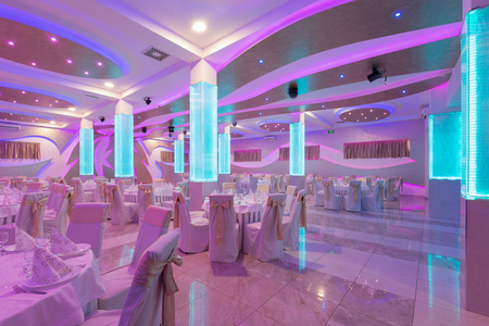 entertaining area: Wedding hall or facility set for fine dining