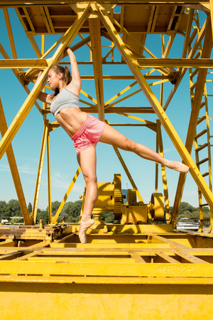Fit fitness woman doing stretching exercises outdoors