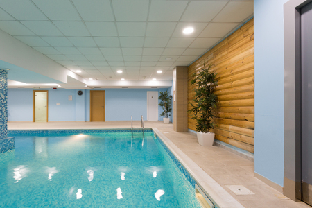 Indoor swimming pool in hotel spa center Stock Photo