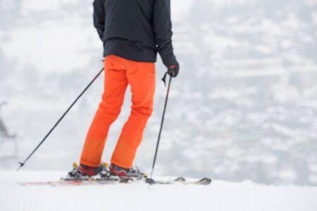 Blurred skier in winter forest mountains, background