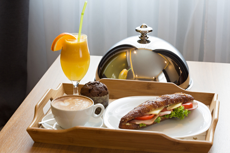 Breakfast on a serving tray in a hotel room Stock Photo