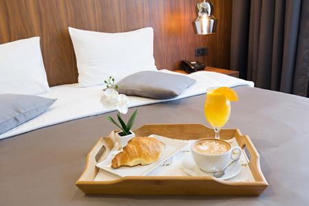 Breakfast in bed, hotel bedroom interior Stock Photo