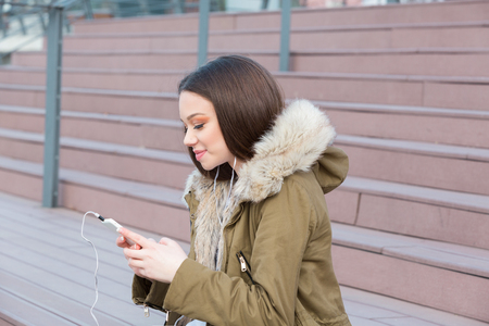 Young woman busy with her mobile phone Stock Photo