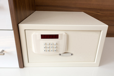 White security safe in hotel room Stok Fotoğraf