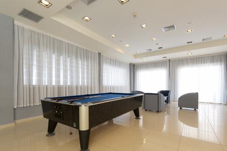 Hotel lounge interior with billiard table Stockfoto