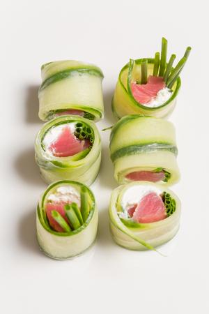 Cucumber rolls with salmon, cream cheese