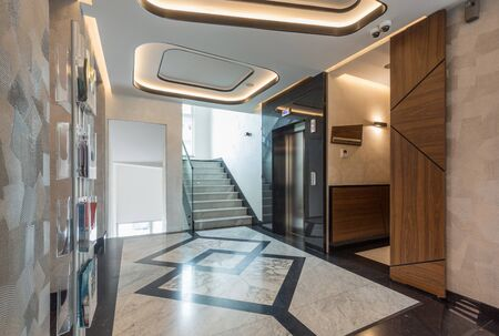 Interior of a shiny marble hotel corridor with elevator Stockfoto