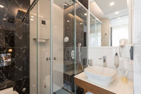 Interior of a luxury hotel bathroom with glass shower cabin Stockfoto