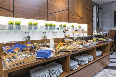 Buffet table, breakfast in hotel restaurant Stock Photo