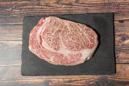 Raw kobe beef on black stone