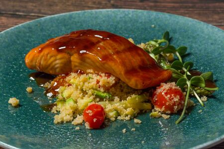 Fried salmon with asparagus and couscous salad