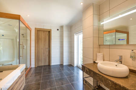 Interior of a hotel bathroom interior with shower cabin Standard-Bild