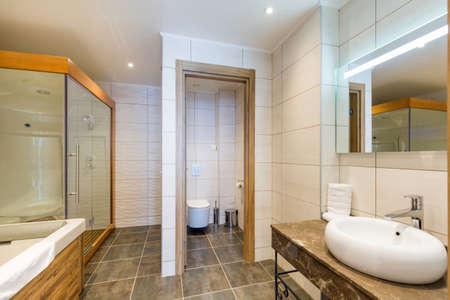 interior of luxury hotel bathroom with hydromassage bathtub and shower cabin Archivio Fotografico