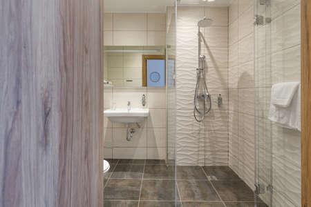 Interior of a hotel bathroom interior with shower cabin