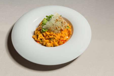 Lemony shrimp risotto served in white plate