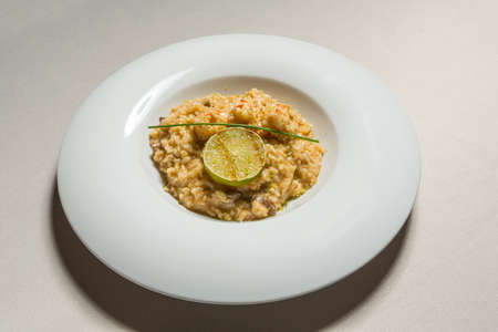 Lime shrimp risotto served in white plate