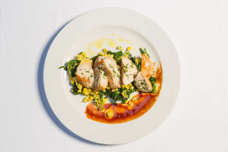 Grilled chicken breasts with cooked vegetables corn and chard