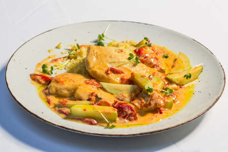 Chicken zucchini couscous served on a restaurant table