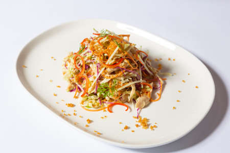 Vietnamese cabbage and chicken salad served on a white plate