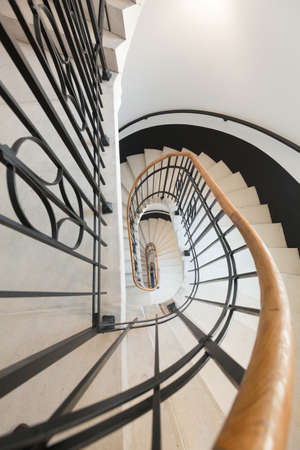 High angle view of spiral staircase winding downward 免版税图像