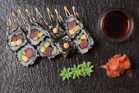 Smoked salmon Philadelphia roll sushi served on blackstone