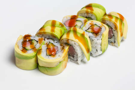 Salmon avocado sushi roll served on a plate