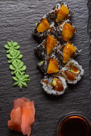 Smoked salmon Philadelphia roll sushi served on black stone Standard-Bild