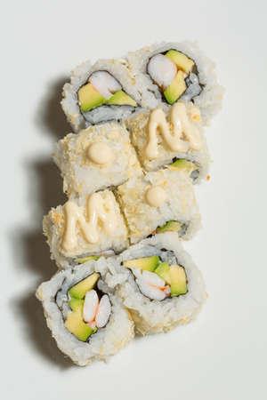 Uramaki sushi with surimi crab, avocado Standard-Bild