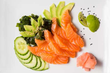 Raw salmon avocado cucumber served on a plate Standard-Bild