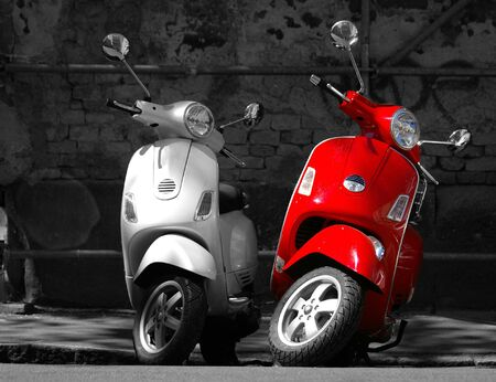 This is two motorcycles in the city. photo