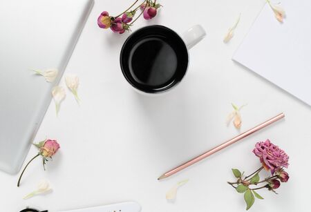 Woman workspace with tablet, flowers, coffee, and pencil on white background. top view 스톡 콘텐츠 - 132049752
