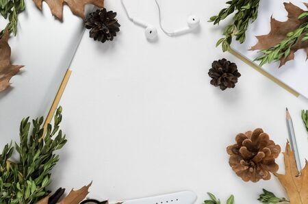 Workspace with tablet, pencil, green branches and pine cones on white background. top view 스톡 콘텐츠
