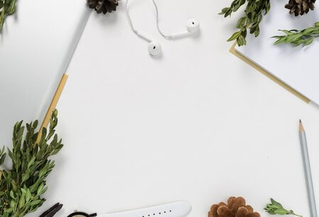 Workspace with tablet, pencil, green branches and pine cones on white background. top view 스톡 콘텐츠 - 132049866