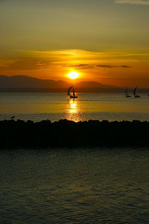 Shilshole bay sunset in Seattle, Washington, with Pudget Sound and sports competition mountains