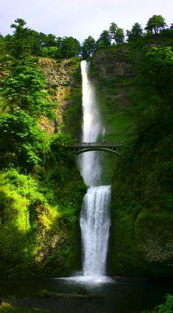 Multnomah Falls near Portland, Oregon, with bridge and people admiring the waterfall.