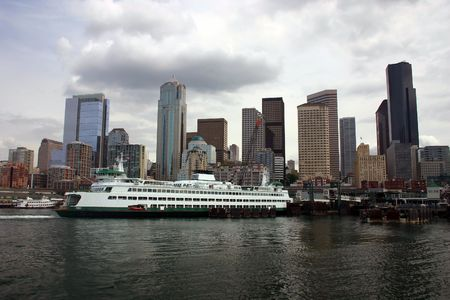 Cloudy Seattle skyline with docked ferry (close up with wide angle lens)