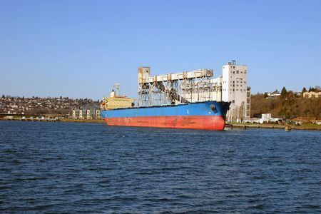 Grain transportation ship is being emptied at Seattle grain cultivator