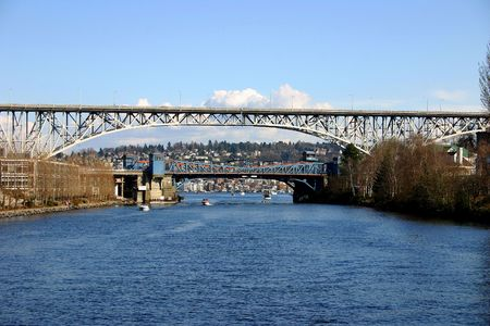 Fremont and Aurora bridges in Seattle on a sunny day, view from Lake Washington Ship Canal
