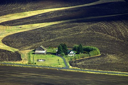 A view of a farm from a scenic viewpoint in hilly Eastern Washington