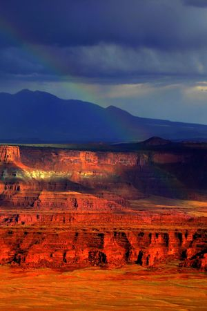 Rainbow and dark stormy skies during a storm in Canyonlands, Utah. Stock Photo - 846309