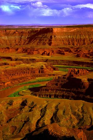 River carves Canyons of the Canyonlands on a stormy Autumn day photo