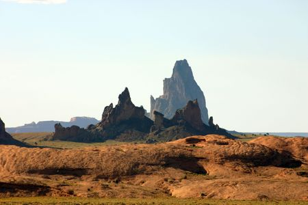 Shiprock formations from far away: a view of rocks in New Mexico