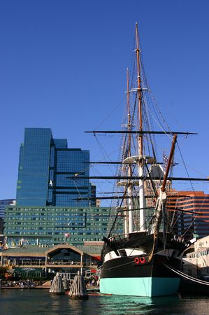 maryland: A historic boat docked in Downtown Baltimore Inner Harbor with skyscrapers in background