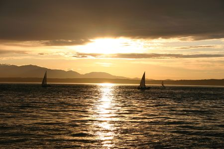 Sunset in Shilshole beach in Ballard, Seattle with sail boats and Olympic mountains