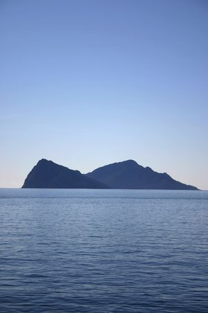 Mountain peaks in Waters of Neah Bay near Seward Alaska