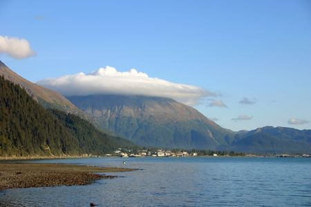 Kenai mountains in Alaska wcovered with a thick cloud photo