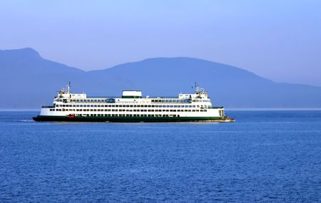 Washington State ferry in Pudget Sound with sports competition mountains hin the background