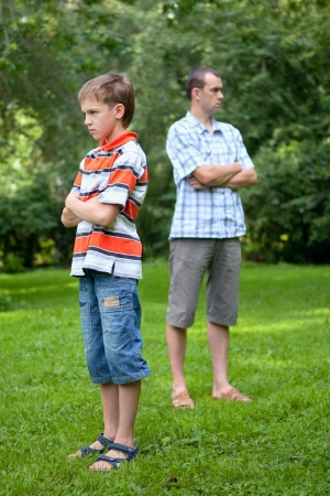 Conflict of father and son, outdoor photo